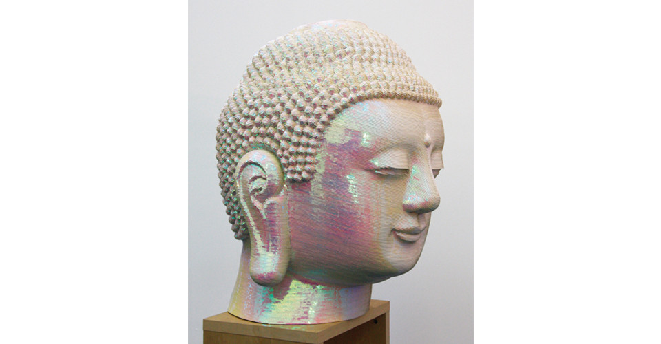 For the Worshipers, 2008, sequins on Buddha head of fiberglass and polyester resin, 92.5 x 70 x 73 cm