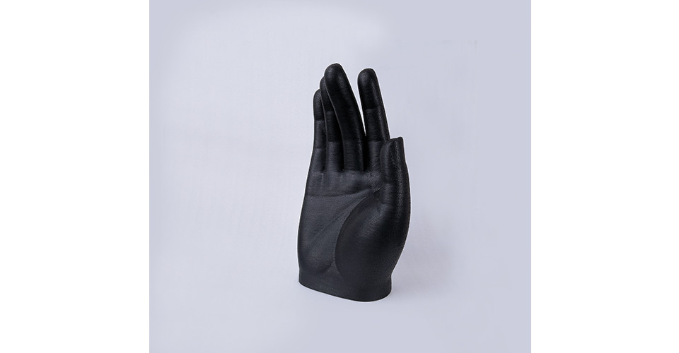 The Glove of Buddha, 2003, sequins on Buddha hand of polyester resin and fiberglass, 74 x 42.8 x 24 cm