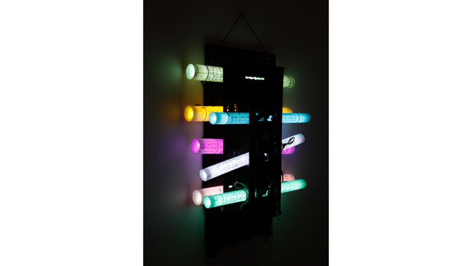 Scrolled Books, 2014, LED in plastic, paper, wood, 60 x 38 cm