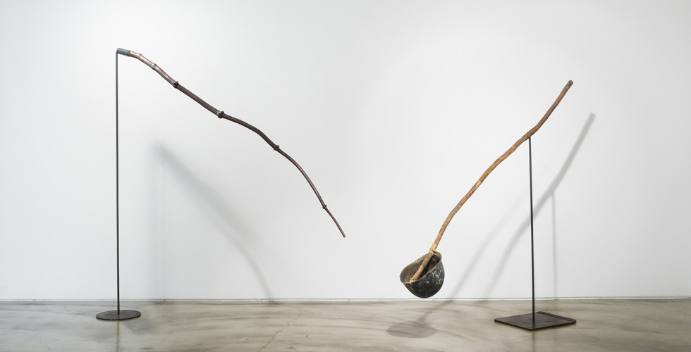 Yoon Dongchun, Politician-Growing Nose, 2011, wood, iron, 168 x 180 x Ø25.5 cm (left), Meaningful Objects-Tools for the Politician, 2011, wooden bar, helmet, 164 x 140 x 75 cm (right)