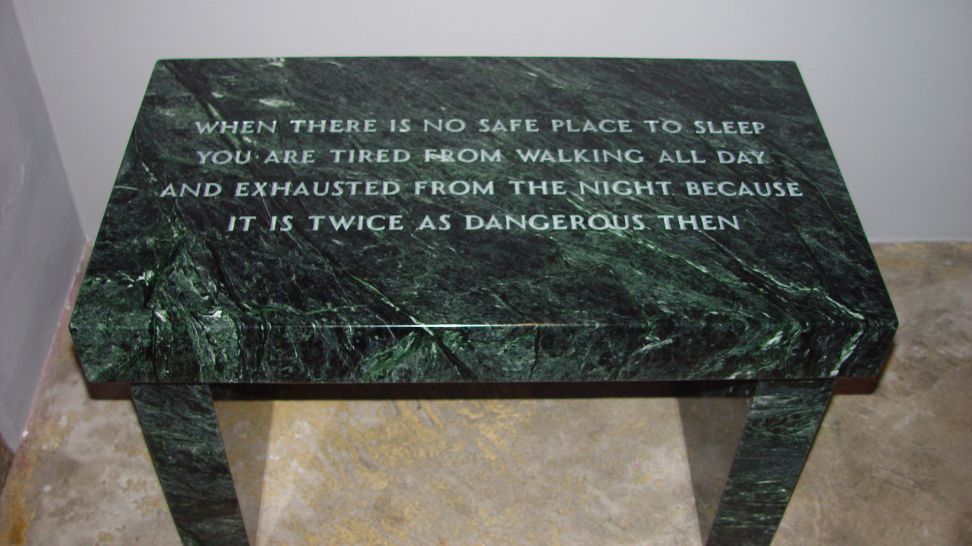 Jenny Holzer, Survival When There's No Safe Place to Sleep, 1997, verde antique marble footstool, markings inscribed under footstool Jenny Holzer, 43.2 x 41.9 x 74 cm