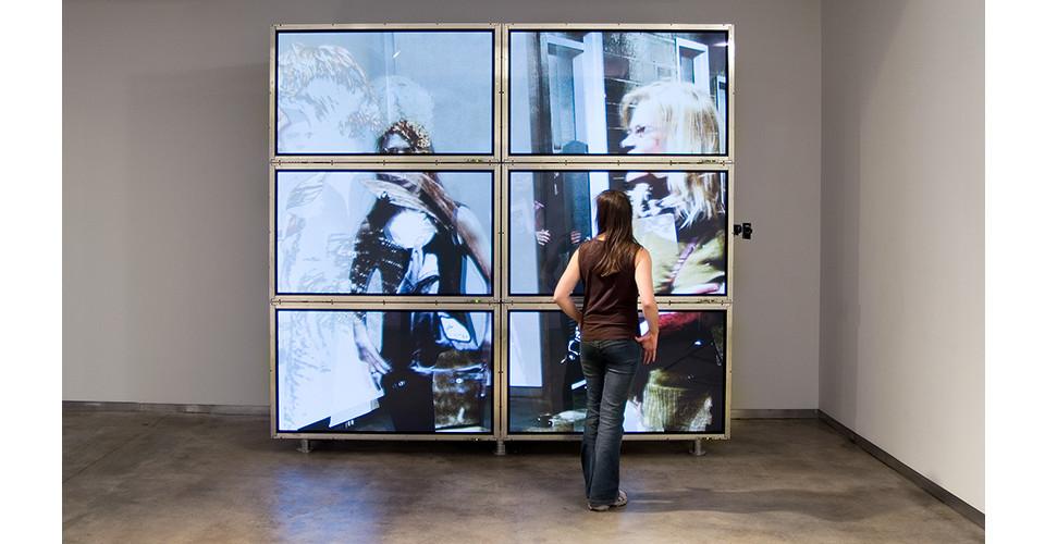 Lincoln Schatz, One Arts Plaza Commission, Dallas, TX, 2007, 2-channel generative video installation, 12 plasma screens, 2 computers, 2 cameras, custom software, 277 x 295 x 124