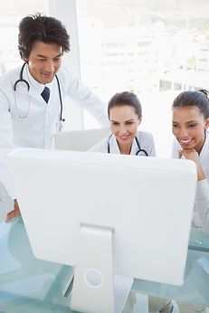 Team of doctors looking at computer screen