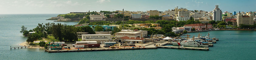 scenic-view-historic-colorful-puerto-rico-city-distance-with-fort-foreground-san-juan_edit