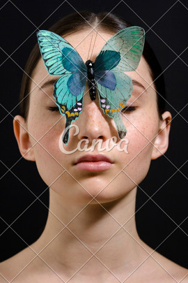 canva-butterfly-covering-face-of-woman-M