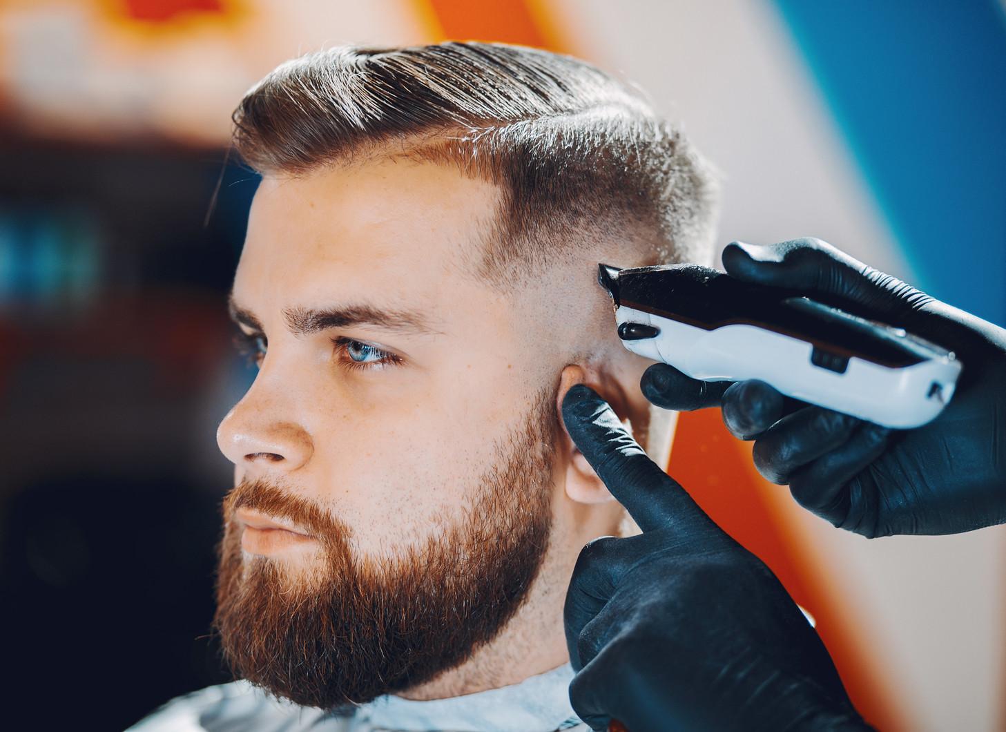 stylish-man-sitting-barbershop.jpg