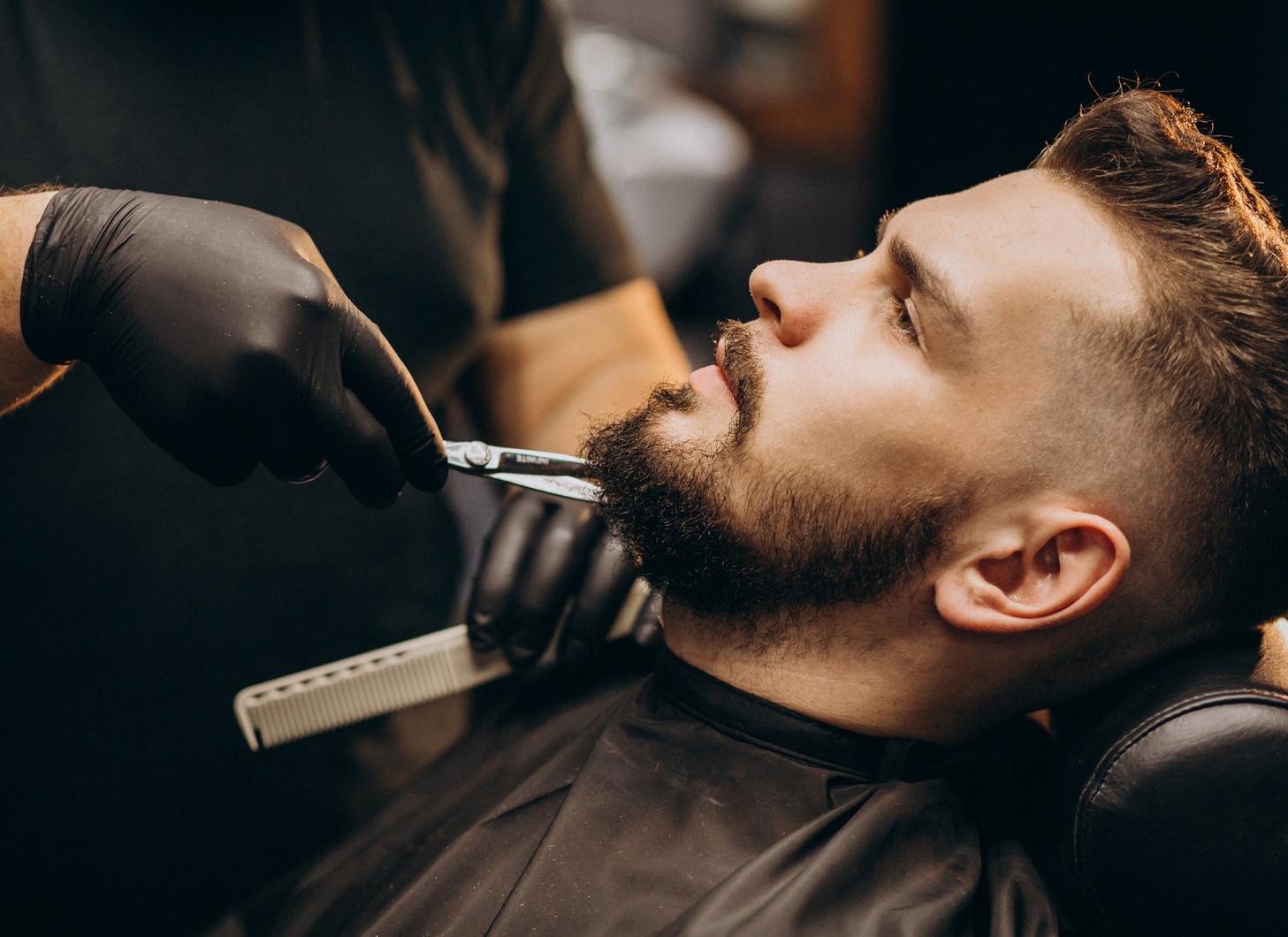 handsome-man-cutting-beard-barber-shop-s
