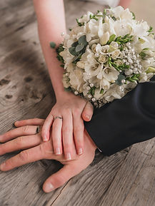 photo-of-hands-with-wedding-rings-and-bridal-bouquet-3818913.jpg