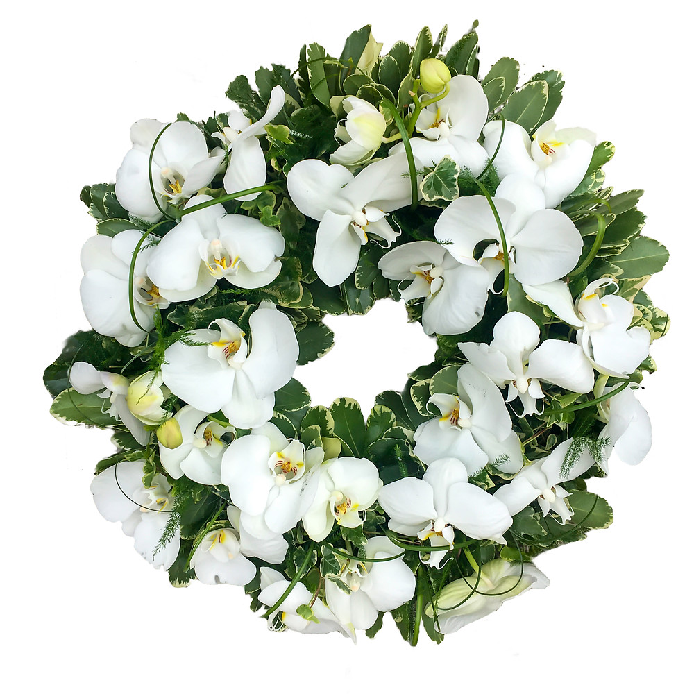 This beautiful floral tribute wreath blossoming with cream and white flowers is the perfect choice for either delivering in sympathy to pay your respects or as a fresh, natural display for a funeral service in memory of the deceased.