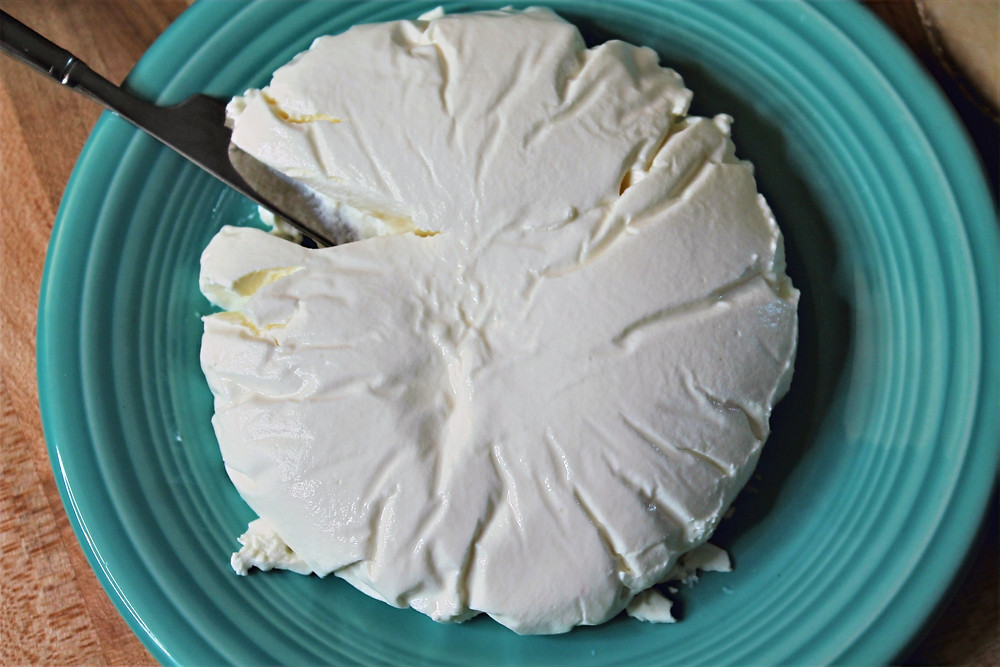 kefir cheese on the plate with butter knife
