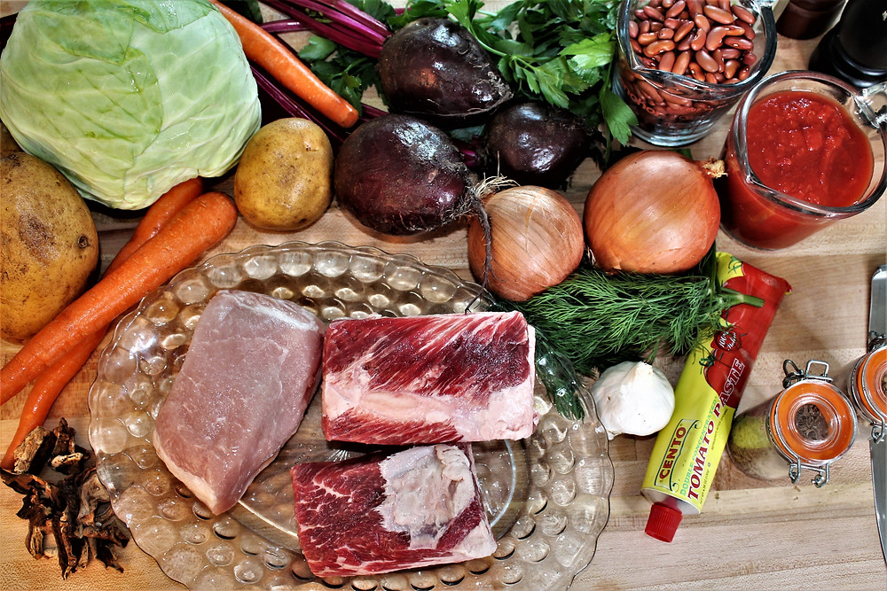 raw meat, onions, carrots, beets, tomato sauce, tomato paste, beans, cabbage, parsley, dill, garlic, dry mushrooms, spices