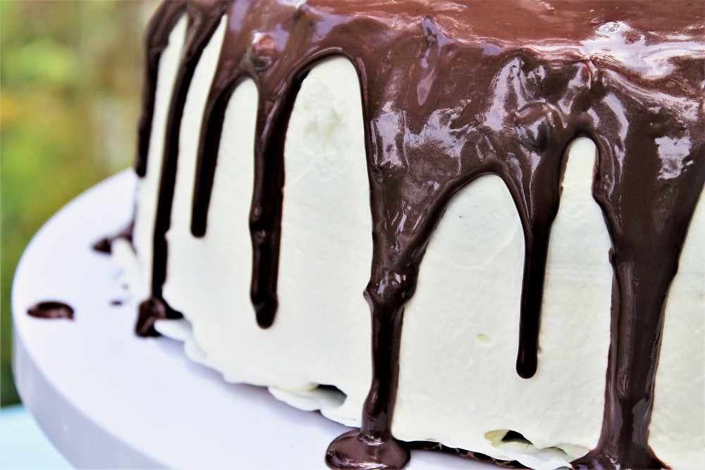 Cake covered with Greek yogurt frosting and chocolate ganache