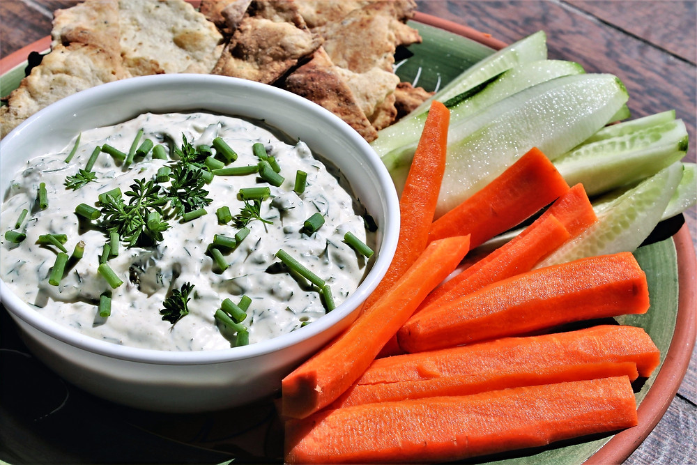 smoke oyster dip with carrots sticks, cucumber and crackers