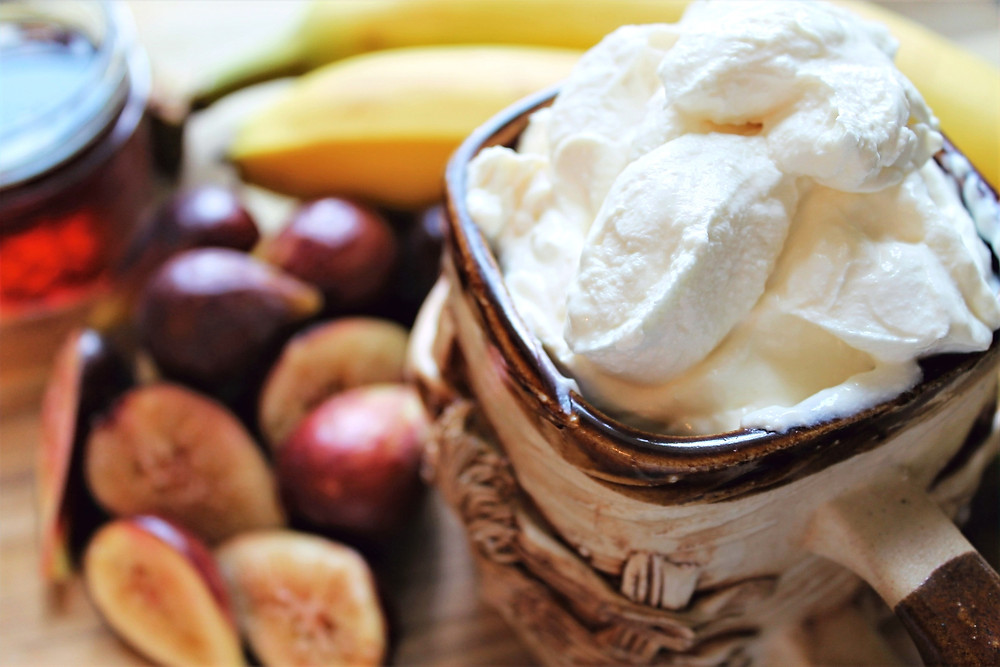 Ingredients for fig-flavored frozen yogurt: bananas, maple syrup, figs, and yogurt