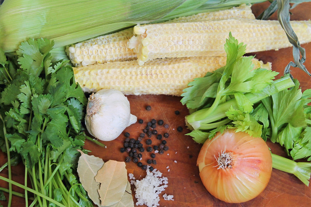 cilantro, celery leaves, onion, garlic, corn cobs, bay leaves, salt, black pepper corns
