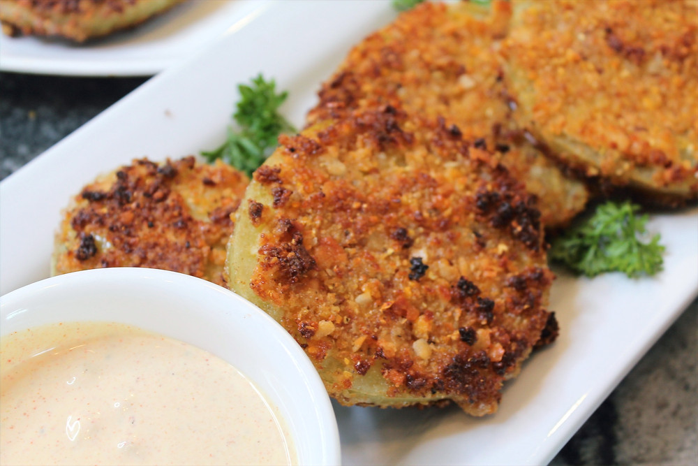 fried green tomatoes on a platter with bowl of aioli
