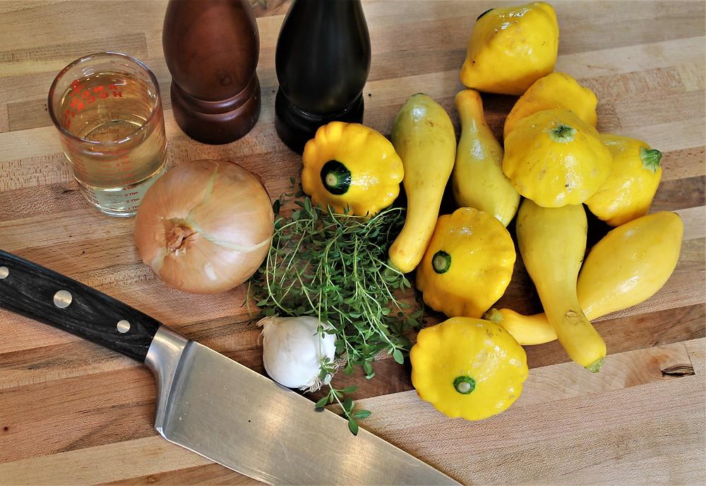 knife, squash, thyme, garlic, white wine, black pepper and salt