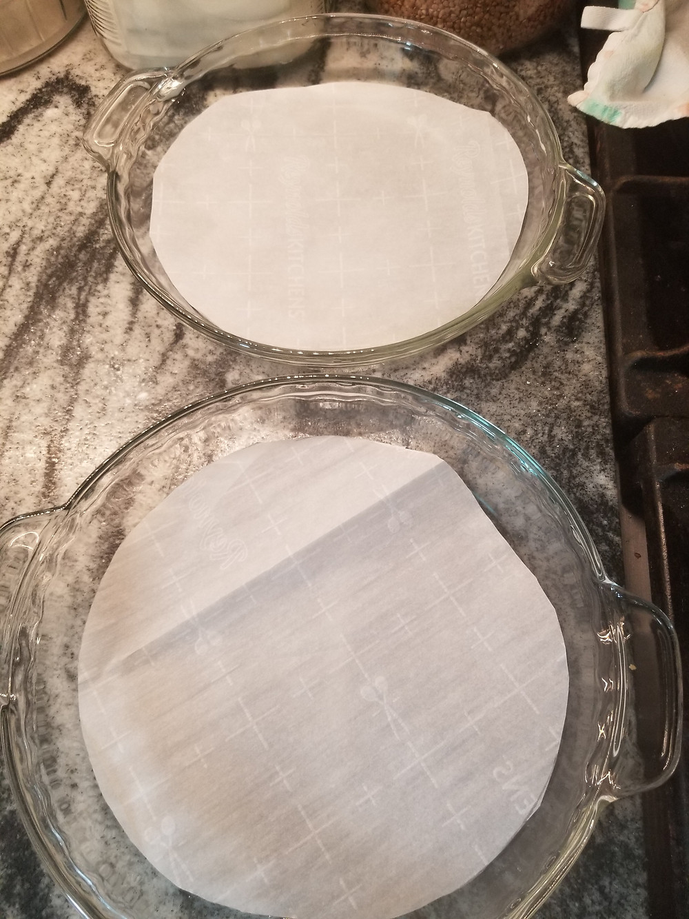 Two baking dishes lined with baking paper