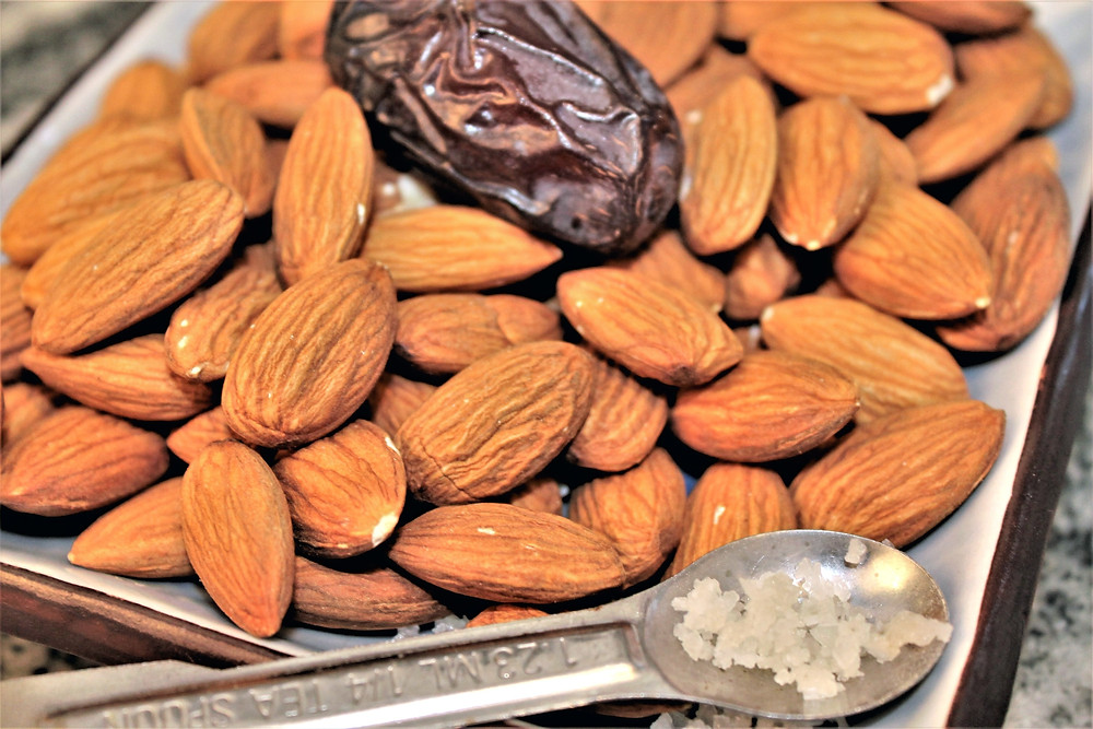 almonds, date, and Celtic salt on a plate