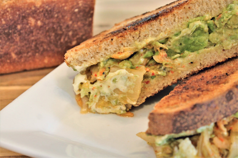 grilled sandwich with aioli, avocado, and kimchi