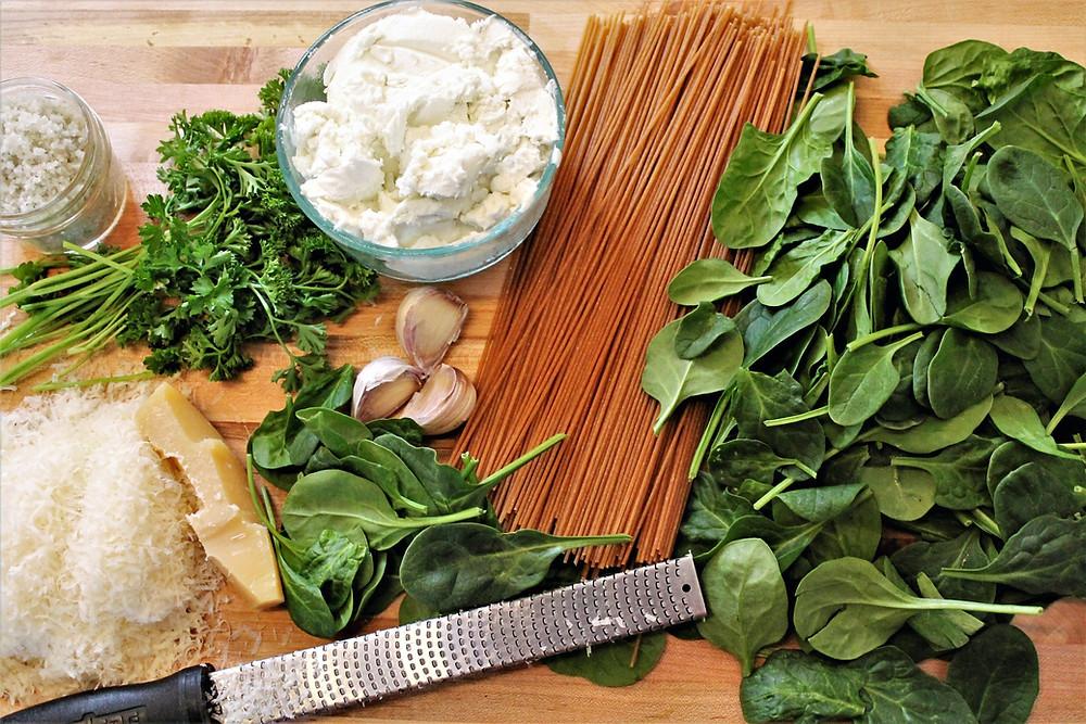 spinach, dried pasta, goat cheese, parsley, garlic. salt, parmesan