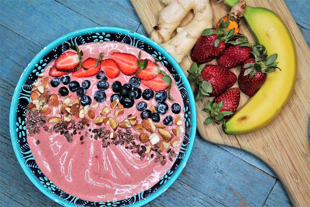 smoothie bowl, banana, strawberries, ginger on board