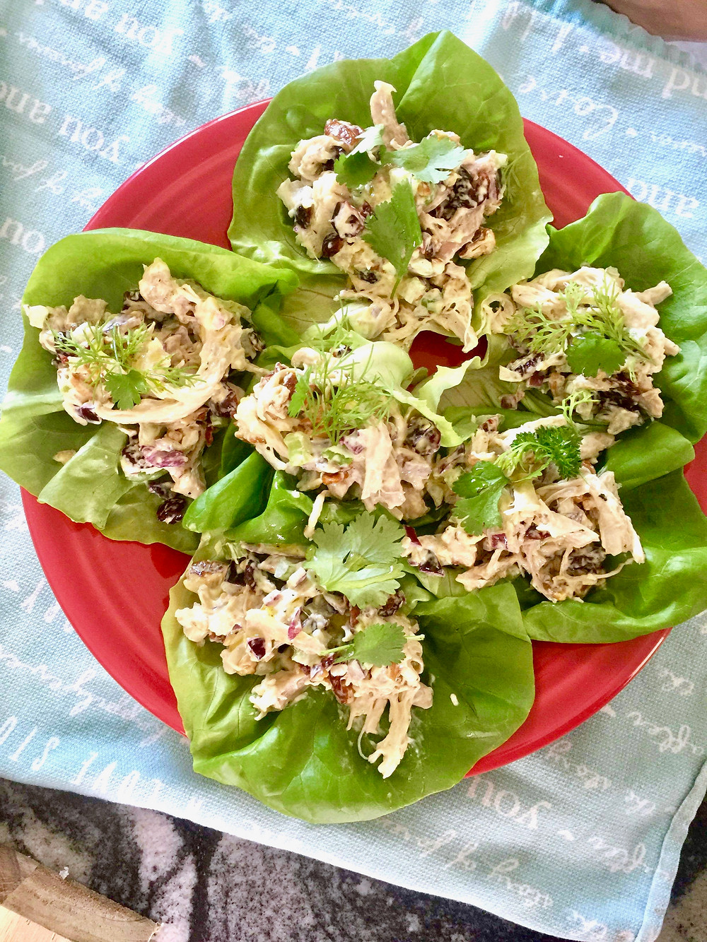 Chicken salad served on a bed of greens