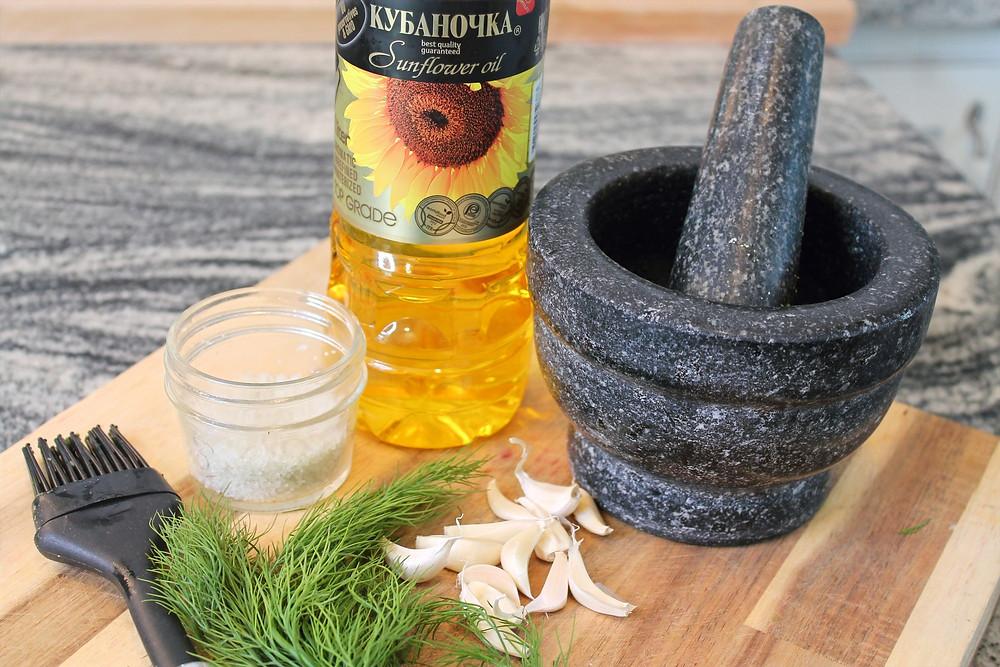 mortar and pestle, sunflower oil, dill, garlic, brush, salt