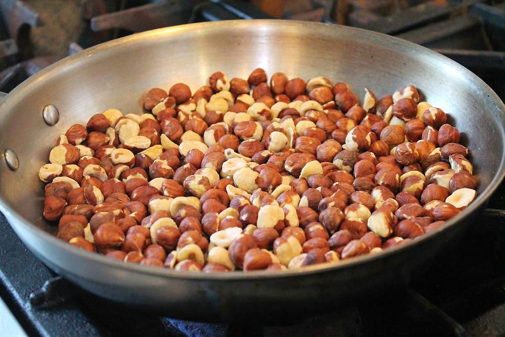 hazelnuts on a frying pan