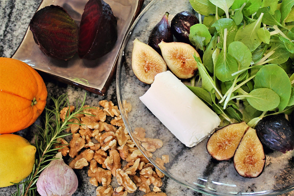 Ingredients for salad and dressing: beets, figs, spinach, goat cheese, walnuts, rosemary, garlic, lemon, and orange