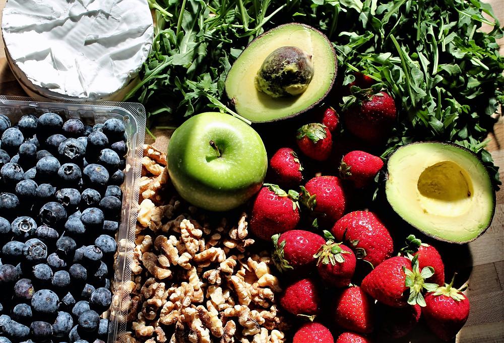 blueberries, brie, walnuts, strawberries. avocado, green apple, arugula