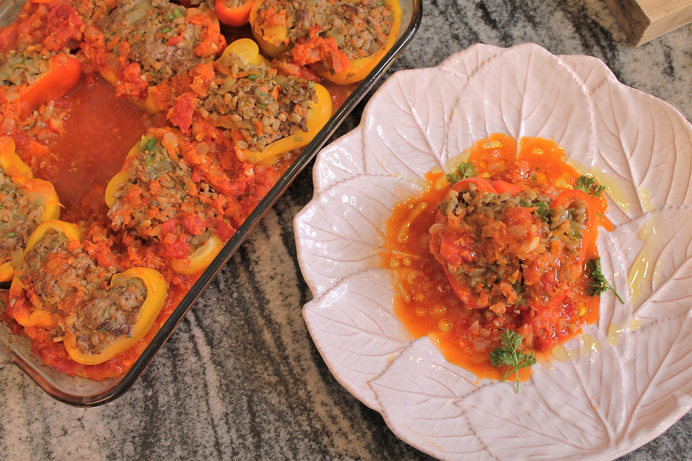 stuffed peppers in casserole dish and on a plate