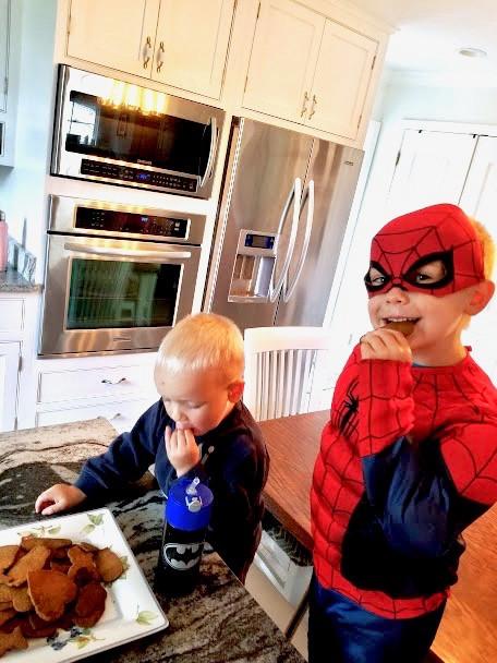 Thomas (dressed as Spiderman) and Johnny enjoying homemade graham crackers