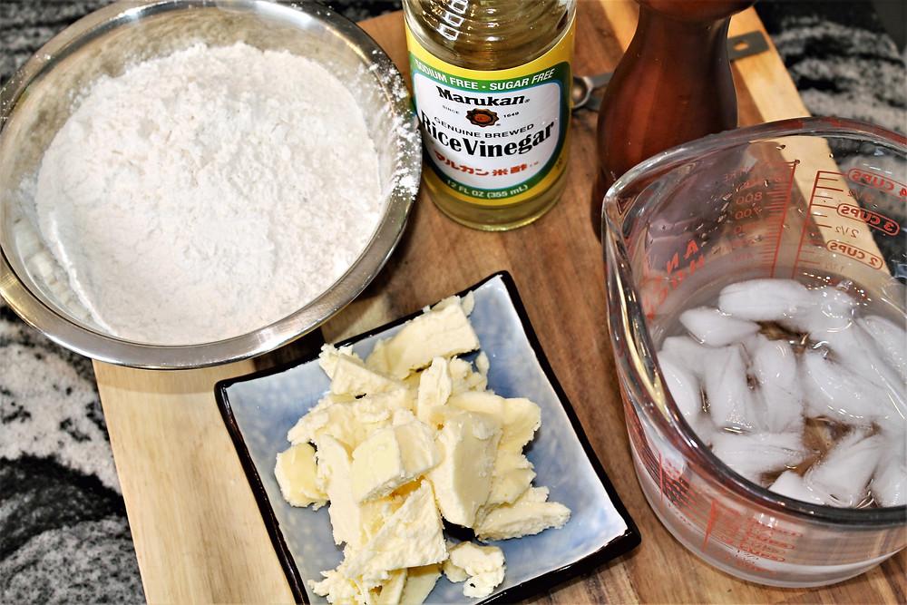 flour, butter cubed, ice water, salt shaker, rice vinegar