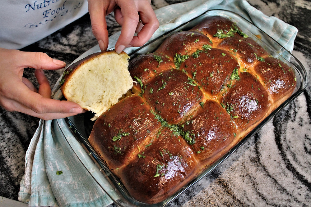 freshly baked bread buns with dill-garlic sauce