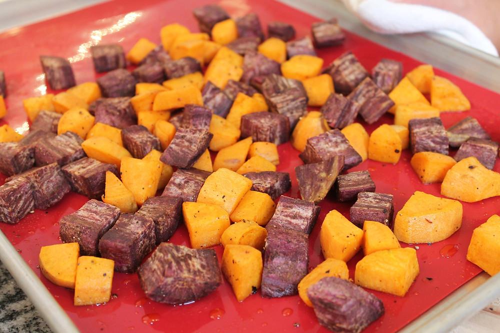 sweet potato cubes on a baking sheet