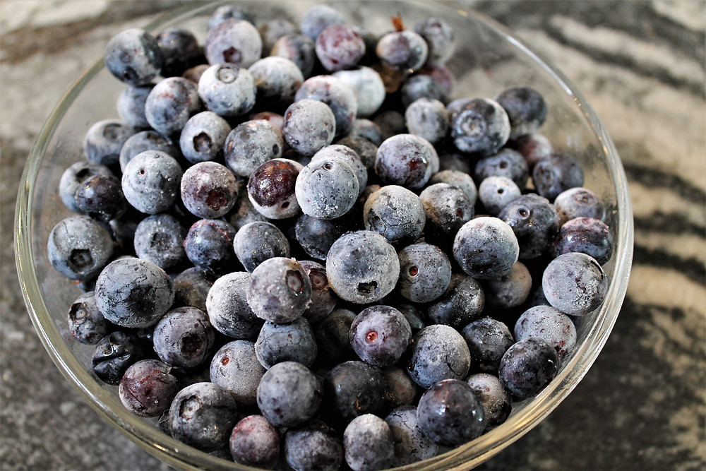 frozen blueberries in a glass bowl