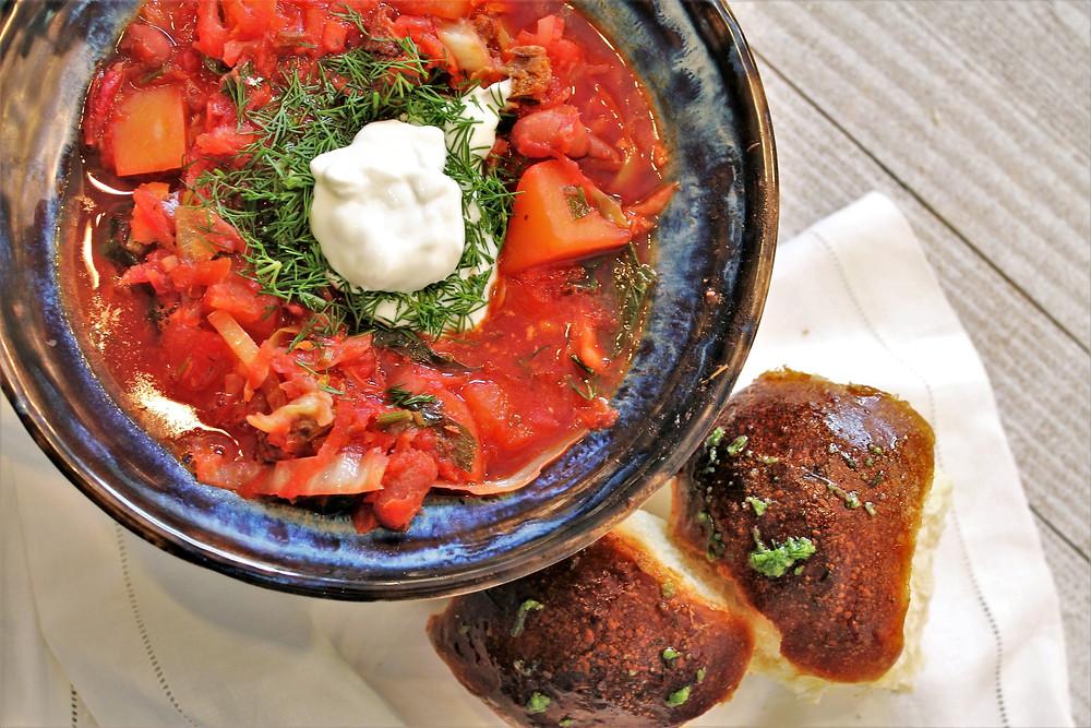 bowl of borsch with bread buns