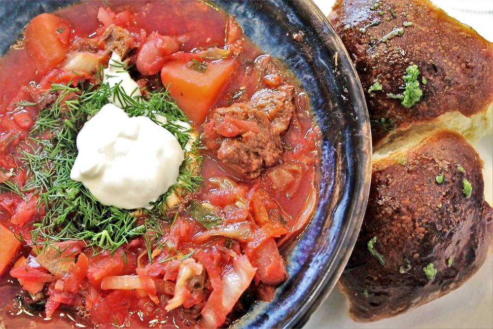 bowl of borsch and bread buns