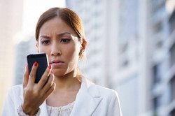 Portrait-sad-business-woman-typing-sms-phone-street-640x426