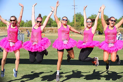 Five fun women runners jumping at Temecula Half Marathon & 5K