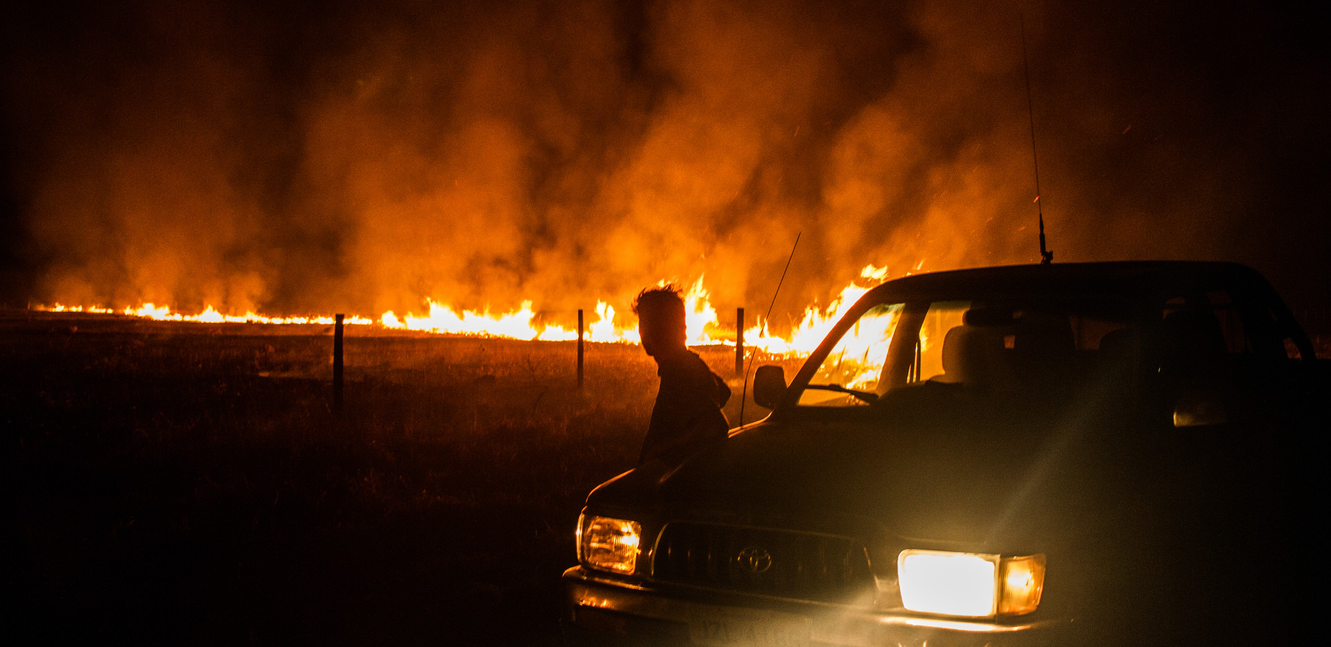 A farmer watches as a fire burns through a field in the District of Bom Jardim, State of Mato Grosso, Brazil. The Cerrado Region is one of the most affected in the Amazon. The hot and dry climate added to strong winds helped to spread the fires rapidly.