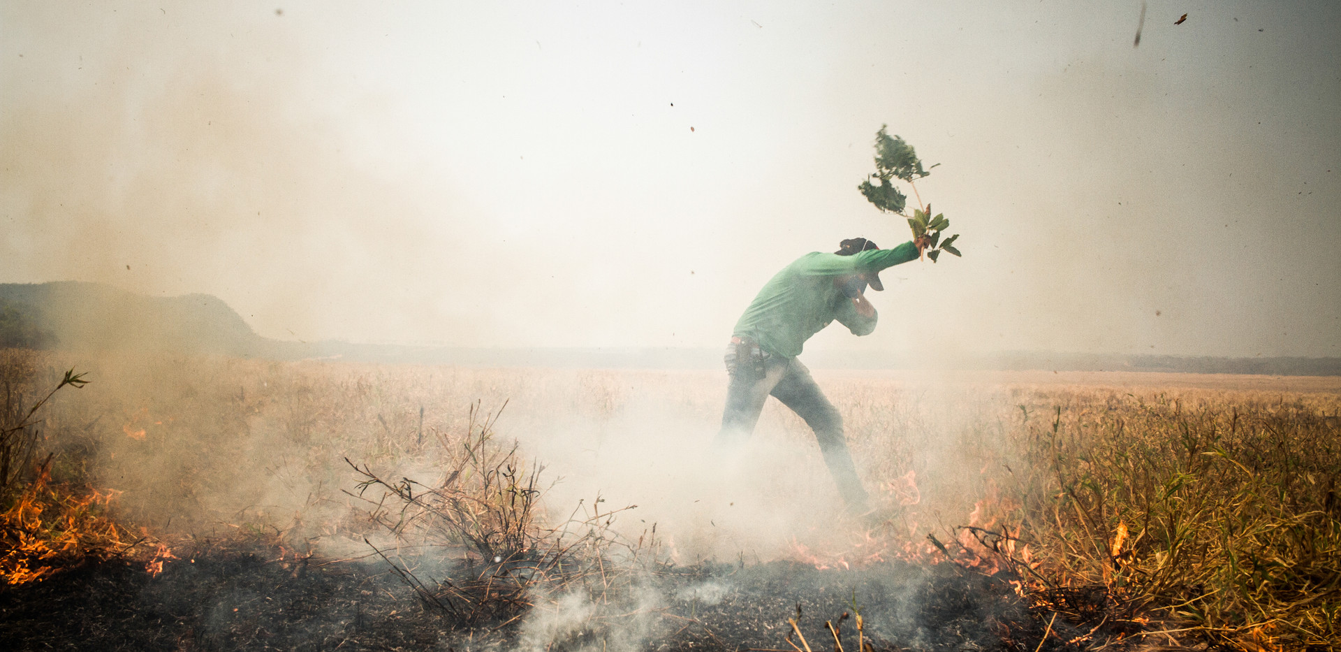 "A local Farmer putting out small fires in a scorched area of a farm in Nobres, State of Mato Grosso. The scorched areas of a fire can still become a danger, as a small spark from a burned tree can trigger another fire in the vicinity. After six hours of fighting, due to high temperatures of the afternoon and strong winds the fire became uncontrollable, no one could do nothing but watch and try to save some small areas of the farm. Lt. Whiby: ""it's really frustrating we did everything we could, but the farm owner really didn't care about any fire safety measure, when the fire came there was no water, tank trucks or enough buffer zones, the result is this all the fields and crops destroyed."""