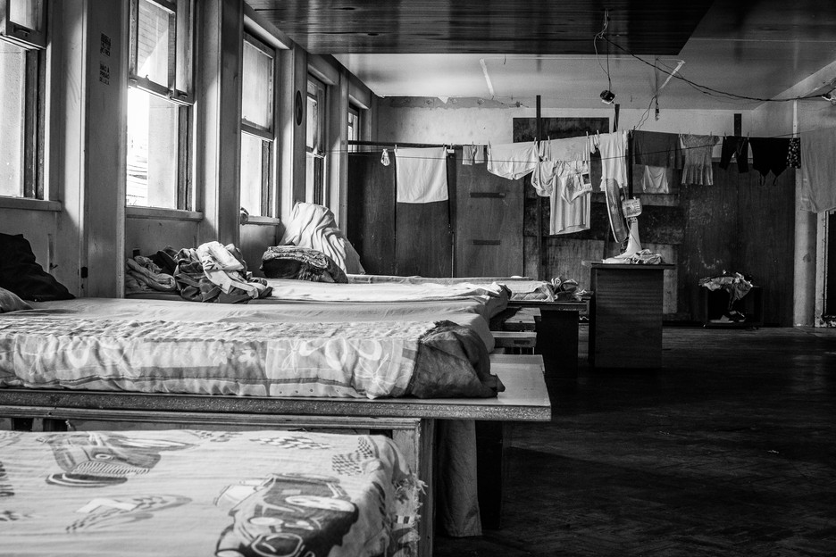 Beds inside one of Marielle Franco Occupation's floors. Inside the occupation, the rooms take different forms. Some build walls inside the buildings, others only have a mattress and some sheets.
