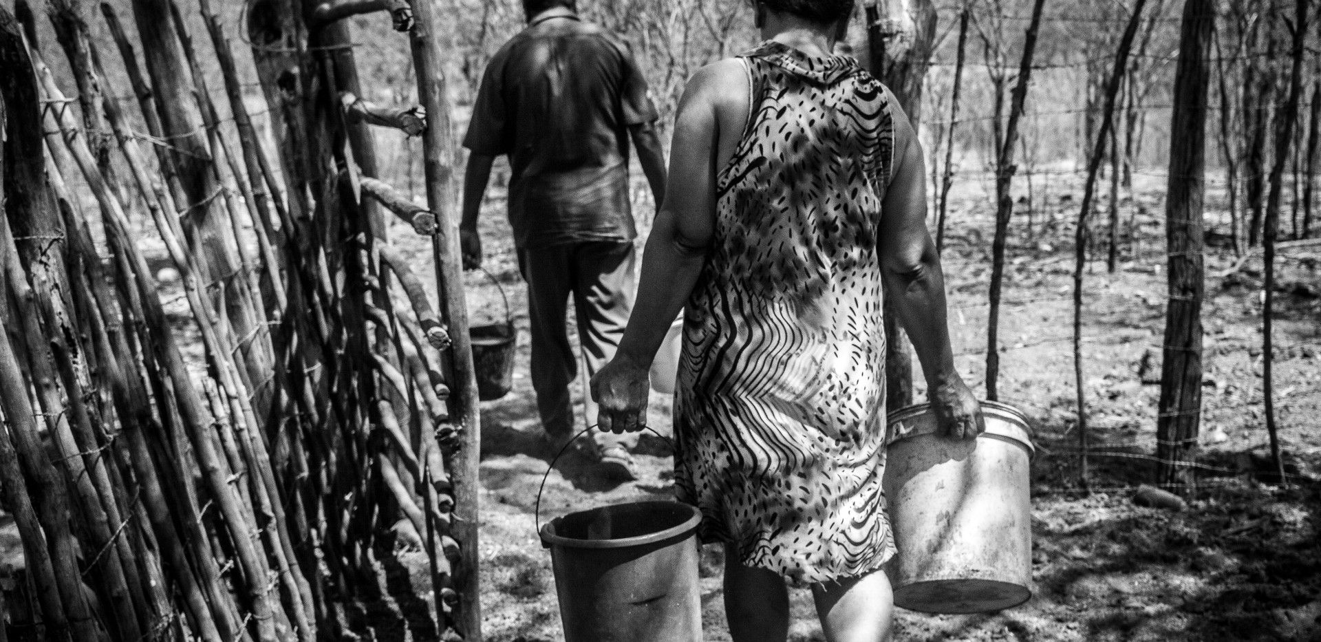 Rosilene de Souza, 46, and her husband Genival Gomes preparing to take water to the pigs at their farm in Sertania, State of Pernambuco, Brazil.
