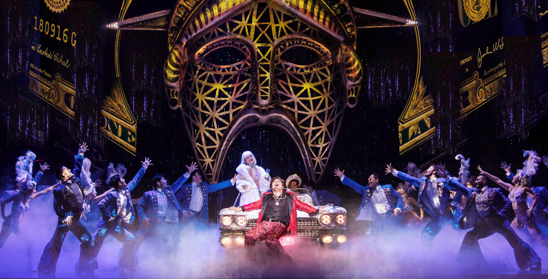 Red Concepción (center as 'The Engineer') and the Company perform 'American Dream' in the North American Tour of MISS SAIGON