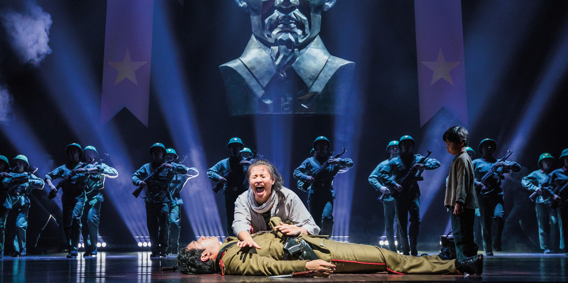 Jinwoo Jung as 'Thuy,' Emily Bautista as 'Kim,' Sarah Ramirez as 'Tam' and the Company in the North American Tour of MISS SAIGON