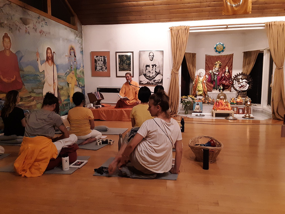 ~Evening Satsang with Swami Dharmananda in Radha/Krishna Temple.Feature wall with Buddha,Christ, and Krishna~