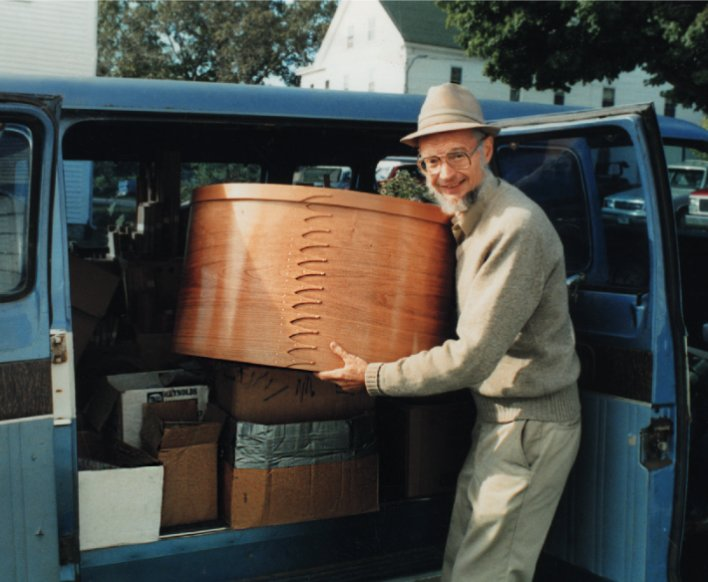 JOHN PUTTING BOX IN VAN
