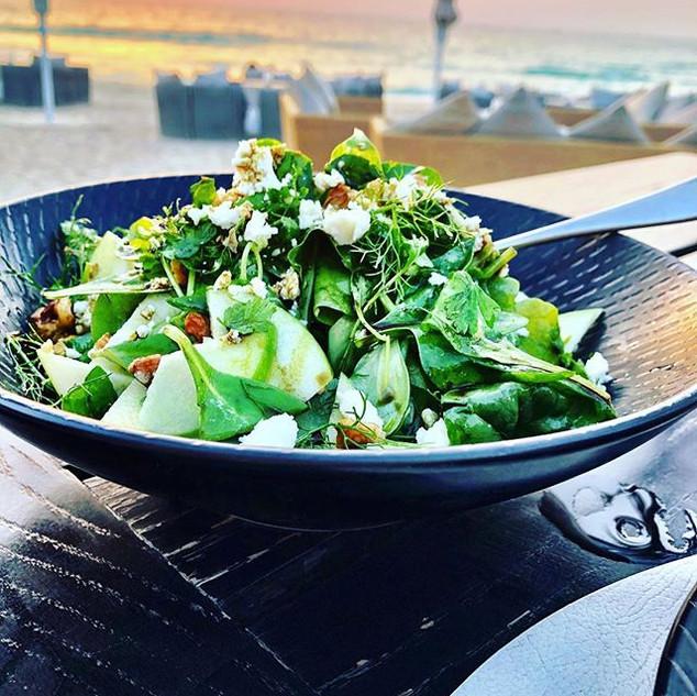 Salad of greens by the sea in Dubai watc
